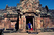 The entrance of Phanom Rung.  You can see the rosy color of the sandstone.         The stone had to move more than 100 Km from a mountain in Cambodia.  Among the sand stones, this rose colored stone is most precious.